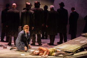 Dodo (mezzo-soprano Eve Gigliotti) looks on as Bess (soprano Kiera Duffy) sacrifices herself for Jan's health. Photo by Dominic M. Mercier for Opera Philadelphia.